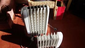 Three broken electric heaters. Free!