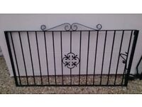 Two unused 6ft by 3ft Iron Gates with iron posts