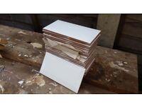 23 white beveled ceramic tiles 20 x 10 cm