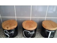 Ceramic coffee, tea and sugar jars with wooden lids