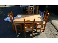 Soild pinewood dining table with 4 pinewood chairs with wicker seats