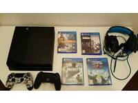 Playstation 4 with 2 playstation controllers 4 games and headphones