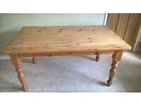 large pine farmhouse table seats six