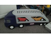 Little Tikes transporter and two racing cars
