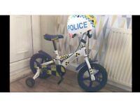 Boys 14 inch police bike & helmet