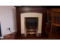 Electric fire with mahogany fire place surround