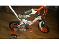 childs first bike with handle.