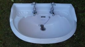 White porcelain wash hand basin with pedestal, Shell design. Taps included