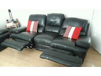2 leather electric reclining sofas