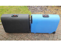 Two, large Carlton hard-sided suitcases