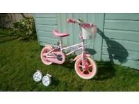 Girls bike with stabilisers.