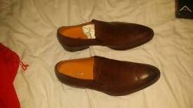 Brown leather pair of shoe