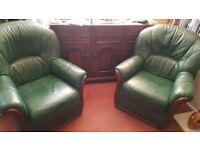 Green leather armchairs