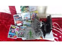 Black wii with 8 games with wii fit board