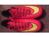 Pink and yellow nike football shoes studded size 11