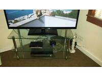 Solid glass TV stand!! Excellent condition!! Can deliver!!
