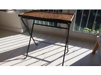Habitat rattan side table, cast iron frame 56 cms wide 33 cms deep 57 cms tall