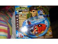 BNIB. Robo fish,water activated, with bowl, castle and fish, 2 extra batteries.