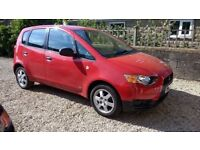 2009 RED MITSUBISHI COLT, 5 DR, 1.1 car - available 9/10th February