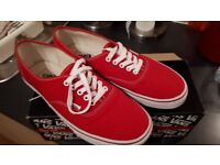 Pair of red shoes (Vans ) worn once ,size 11 adult .tiny mark on one ,great bargain !