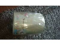 Winnie the pooh light shade with additional rolls of winnie the pooh wallpaper to go with.