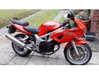 Lovely Red Suzuki 650S looking for a good home.
