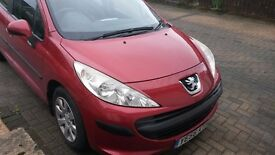 Red Peugeot 207