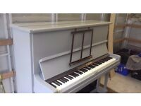 Up right piano for sale... professionally painted grey in colour... looks very nice