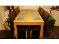 Dining table with 6 brown leather seats