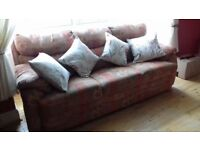 3seater reids couch ,perfect condition,terracotta/multi coloured