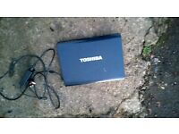 toshiba laptop with bag and accessories
