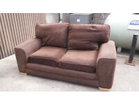 Brown fabric 3 and 2 sofas.