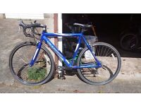 Racing Bike with indoor training equipment
