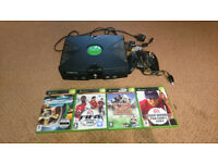 Xbox Console with games with 360 games and xbox one games