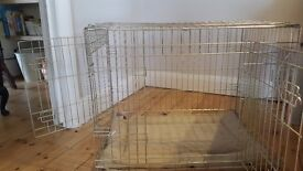 Medium size dog crate with 2 doors, tray & bedding.