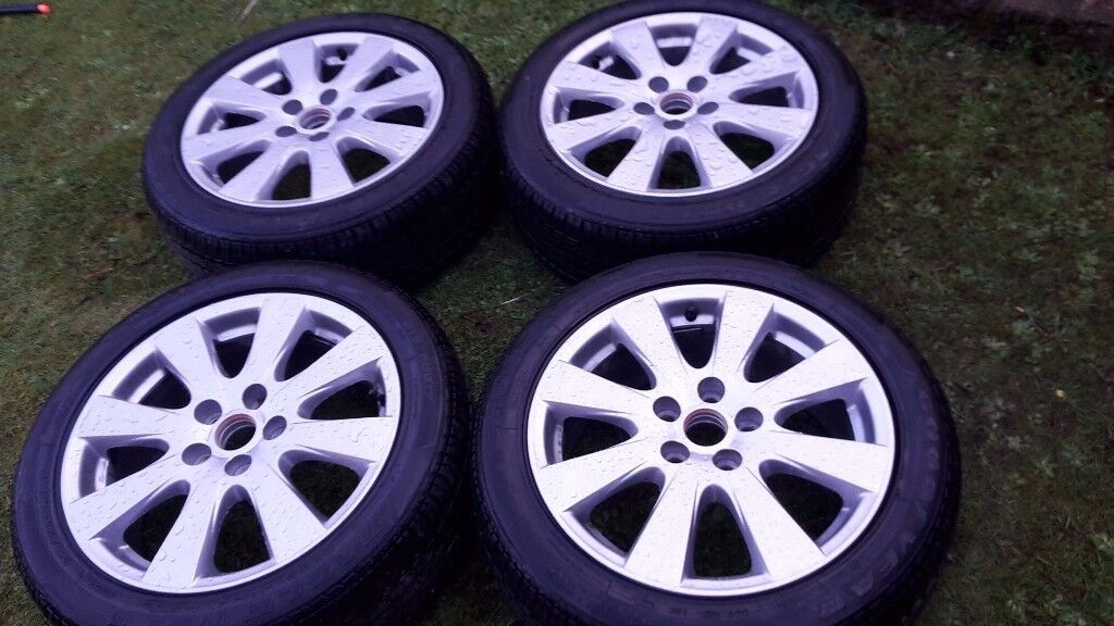 new wheels with new tyres,size 215/50R17,tel nr07756091064