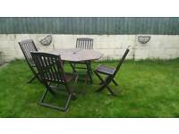 Folding wooden garden table and four chairs