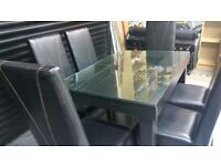 Brown leather look dining table with matching 6 high back chairs - can deliver