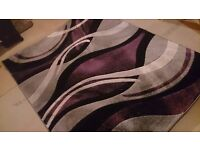 Purple, black, silver and white rug £50