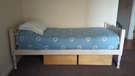 Painted wooden single bed with Ikea mattress