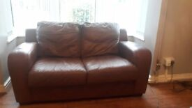 Sofa leather tan 2+3 seater with poufee
