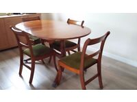 Polished wood extending table & 4 chairs