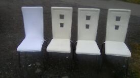 Four creme high back dining chairs + fitted chair covers