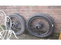 Two vintage car wheels