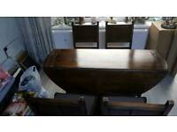 Drop leaf round dining table and 4 chairs solid oak carved furniture