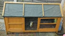 Rabbit hutch with felt roof