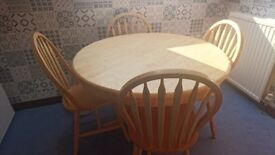 Solid pine round table and chairs.