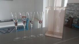 4 x New Champagne Glasses in original box