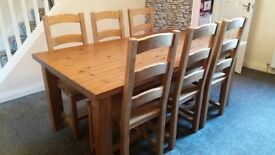 Solid pine dining table and 6 chairs. Ideal shabby chic project