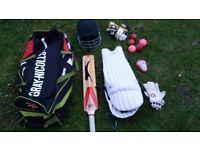 Junior Cricket pads, green hunts helmet 54-63cm, bat 26inch, 5xballs and bag, box and gloves.